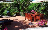 Beautiful Summertime Mediterranean Style Courtyard Garden Setting. poster