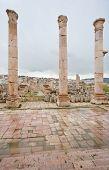 picture of artemis  - view through antique Artemis temple in ancient city Gerasa to modern Jerash Jordan - JPG