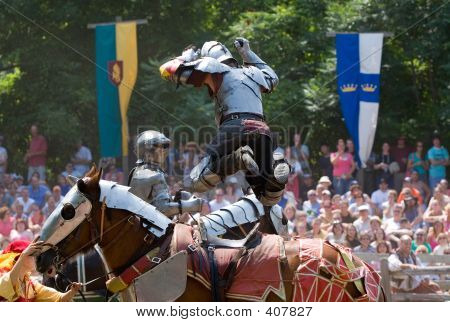 Picture or Photo of Knights battling at a rennaissance festival; in horizontal orientation