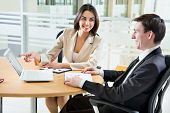 picture of real-estate-team  - Two happy business people in a meeting at office - JPG