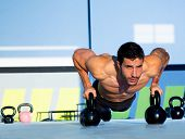 stock photo of abdominal muscle man  - Gym man push - JPG