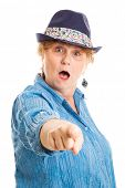 Pretty middle aged woman shocked and pointing an accusing finger at the camera.  White background.