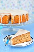 stock photo of torta  - Traditional Italian carrot and almond cake (torta di carote) topped with sugar glaze