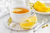 foto of stimulating  - Tea with lemon and herbs in a cup - JPG