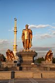 pic of turkmenistan  - Monumen of Niyazov and Arch of Independence in sunset - JPG