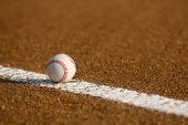 stock photo of infield  - Baseball on the Infield Chalk Line with room for copy - JPG