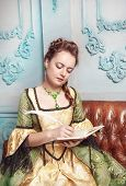 Beautiful Woman In Medieval Dress Writing In Diary