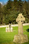 stock photo of headstones  - Celtic headstone in a church burial ground