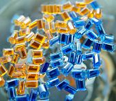 blue and yellow plastic polymer granule