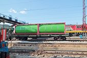 stock photo of cistern  - Green cistern of freight train at railway station with many electric wires at summer - JPG