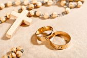 stock photo of humble  - still life with wedding rigs aand rosary