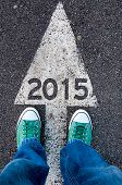 image of snickers  - New year concept with human legs from above standing on 2015 sign - JPG