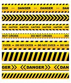 stock photo of dangerous  - Yellow security warning tapes set with text Caution - JPG