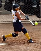 "image of fastpitch  - ""some photoshop done to eliminate all logos"" Teen fastpitch softball player making contact with the ball - JPG"