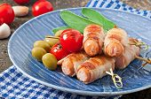 image of bacon strips  - Grilled sausages wrapped in strips of bacon with tomatoes and sage leaves - JPG
