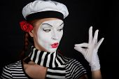 foto of clown rose  - Portrait of a mime comedianon black background - JPG