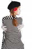 stock photo of clown rose  - Portrait of a mime comedian girl hugging herself isolated over white background - JPG