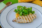 foto of cheese-steak  - Chicken steak with garlic and lemon herbs salad with corn - JPG