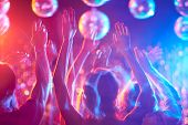 image of clubbing  - Crowd of young people dancing in night club - JPG