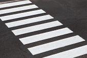 picture of zebra crossing  - White stripes of a zebra crossing on the road - JPG