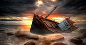 picture of storms  - Fishing boat beached in storm in the stone beach - JPG