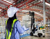 image of sugar industry  - Forklift loader with big bag of sugar in distribution warehouse - JPG