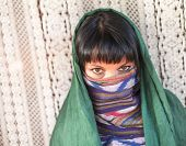 stock photo of hijabs  - Young girl covers her face with a veil - JPG