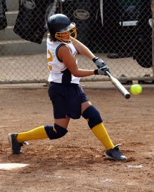 """image of fastpitch  - """"some photoshop done to eliminate all logos"""" Teen fastpitch softball player making contact with the ball - JPG"""