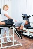 stock photo of physical therapist  - Patient at the physiotherapy doing physical exercises with therapist with sport doctor - JPG