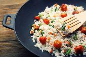 foto of rice  - Tasty rice preparing in wok - JPG