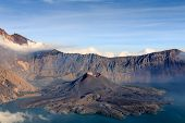 picture of gunung  - Mount Rinjani volcano and volcanic cone in a cloud covered crater lake in Asia - JPG