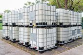 foto of container ship  - Bulk fluid shipping containers on location ready for shipment - JPG