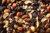 stock photo of mixed nut  - Raw Organic Homemade Trail Mix with Nuts and Fruits - JPG