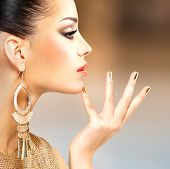 picture of minx  - Profile portrait of the beautiful fashion woman with black makeup and golden manicure - JPG