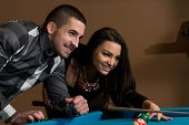 foto of pool ball  - Young Caucasian Woman Receiving Advice On Shooting Pool Ball While Playing Billiards - JPG