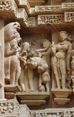 image of building relief  - Stone carved erotic bas relief in Hindu temple in Khajuraho - JPG