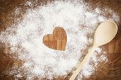picture of ginger bread  - Heart of white flour on a wooden board - JPG