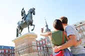 picture of king  - Madrid tourists on Plaza Mayor looking at statue of King Philip III - JPG
