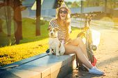 image of hot dogs  - Happy Hipster Girl with her Dog and Bike in the City - JPG