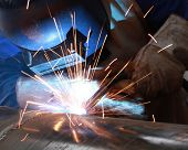 picture of pipe-welding  - welder is welding big pipe with all safety - JPG