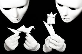 image of shadoof  - White theatrical mask and paper origami isolated on black - JPG