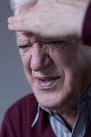 stock photo of sinuses  - Portrait of suffering man having sinus pain - JPG