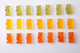 picture of gummy bear  - Rows of colorful gummy bears isolated over white background - JPG