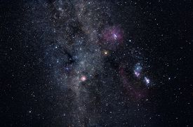 stock photo of cosmic  - Deep space image containing constellations Orion Monoceros Gemini and many bright nebulae and star clusters - JPG