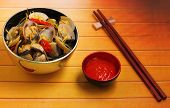 stock photo of clam  - herbal clam soup Vietnam style served on a wood table top - JPG