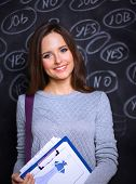image of yes  - Thinking young woman with yes or no choice on grey background - JPG