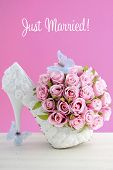 image of blue rose  - Wedding day pink and white bouquet of silk roses with blue butterflies and white high heel shoe - JPG