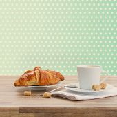 stock photo of croissant  - white cup with fresh espresso  coffee and croissant - JPG