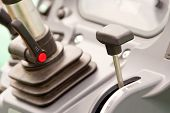 image of levers  - Close up of lever in agricultural vehicle - JPG