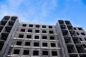 stock photo of reinforcing  - Unfinished building of reinforced concrete panels without windows - JPG